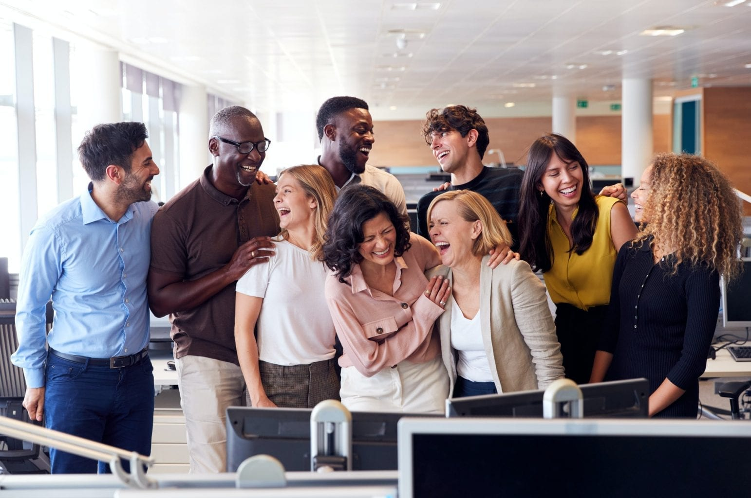 Happy Business Team Working In Modern Office Laughing Together